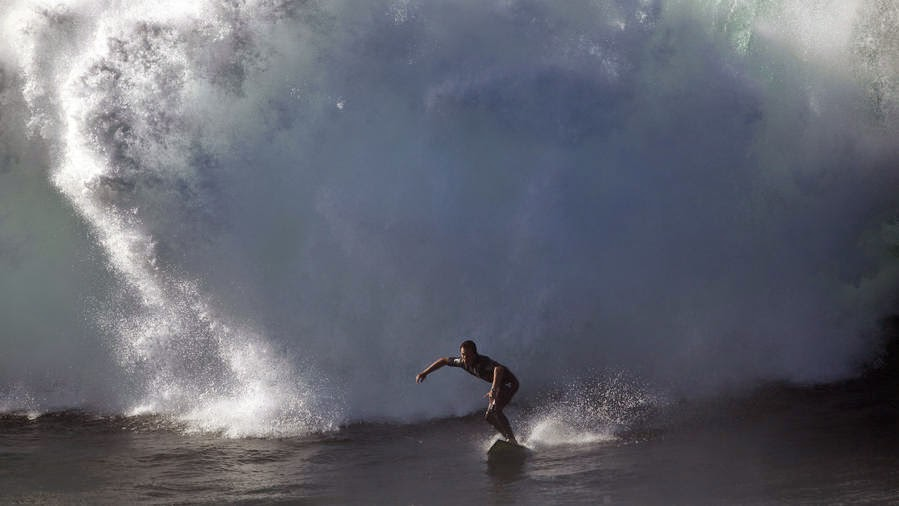 News - Surfers race to catch massive waves across Southland