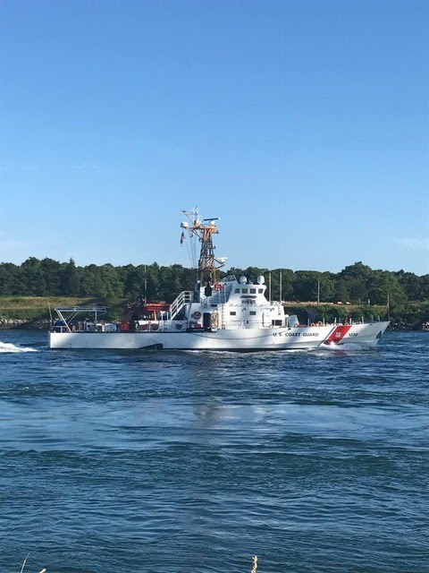 coast guard passing through the canal