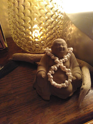 Clay statue of fat happy jolly relaxed buddha