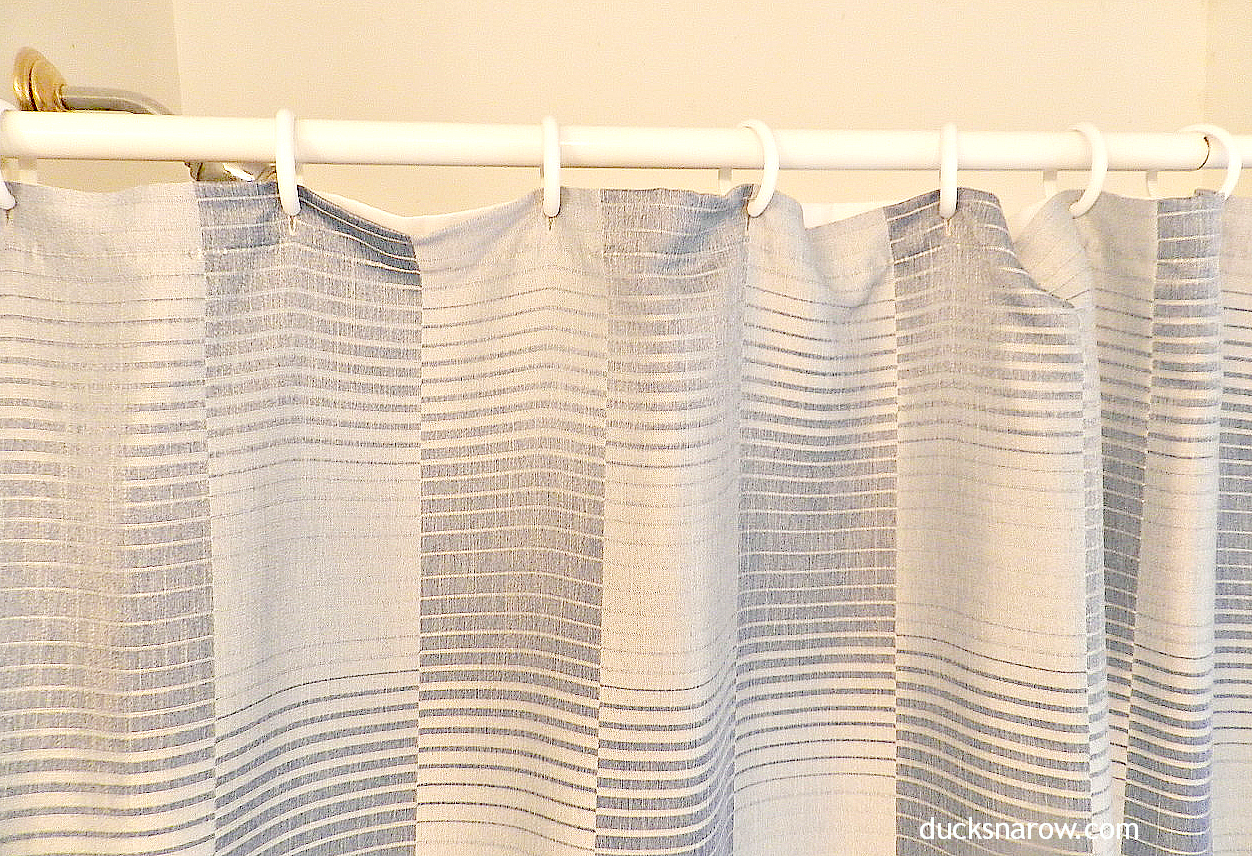 Easy technique for hanging fabric shower curtains with liners.