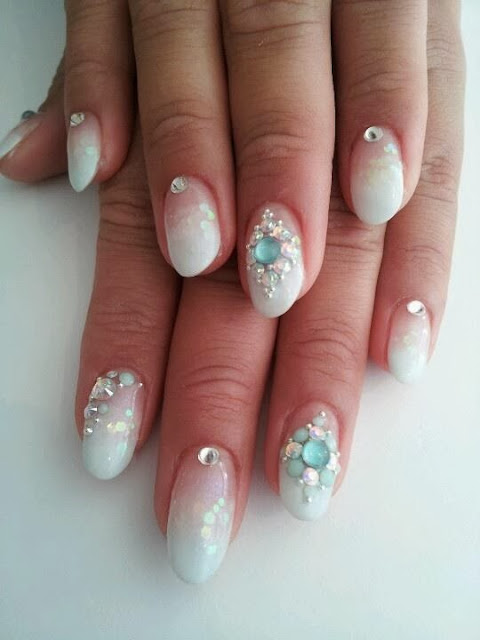 wedding to attend on Saturday so this is sculpted white gels with embedded sequins - crystals for embellishments Nail Art Design