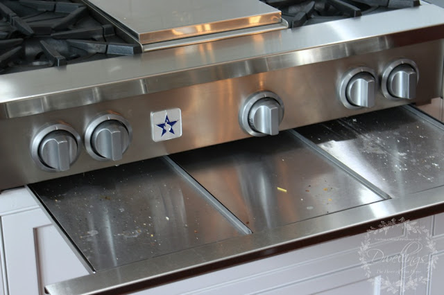 cleaning the gas range top drip pans