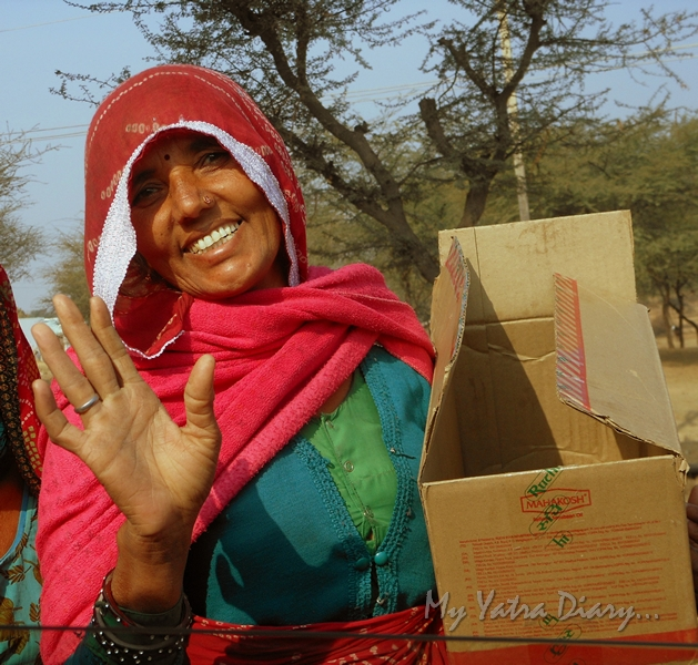 A wandering nomad, banjara woman on the road in Rajasthan