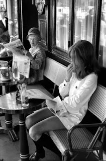 photograph of two women in a paris cafe terrace by henri cartier-bresson