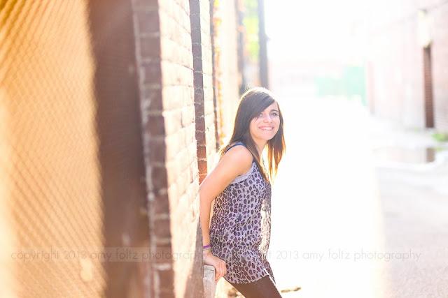 urban portrait of a high school girl in an alley