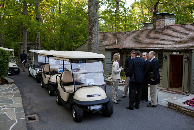 President Obama outside Aspen Lodge at Camp David - with golf carts