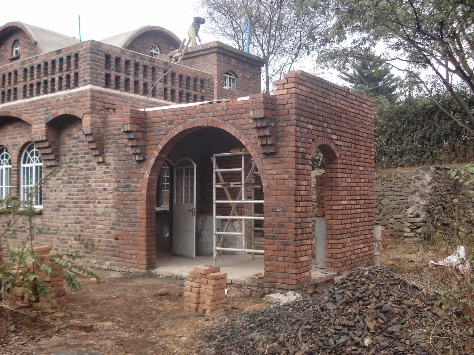 Alternative building construction in tanzania catalan for House roof construction