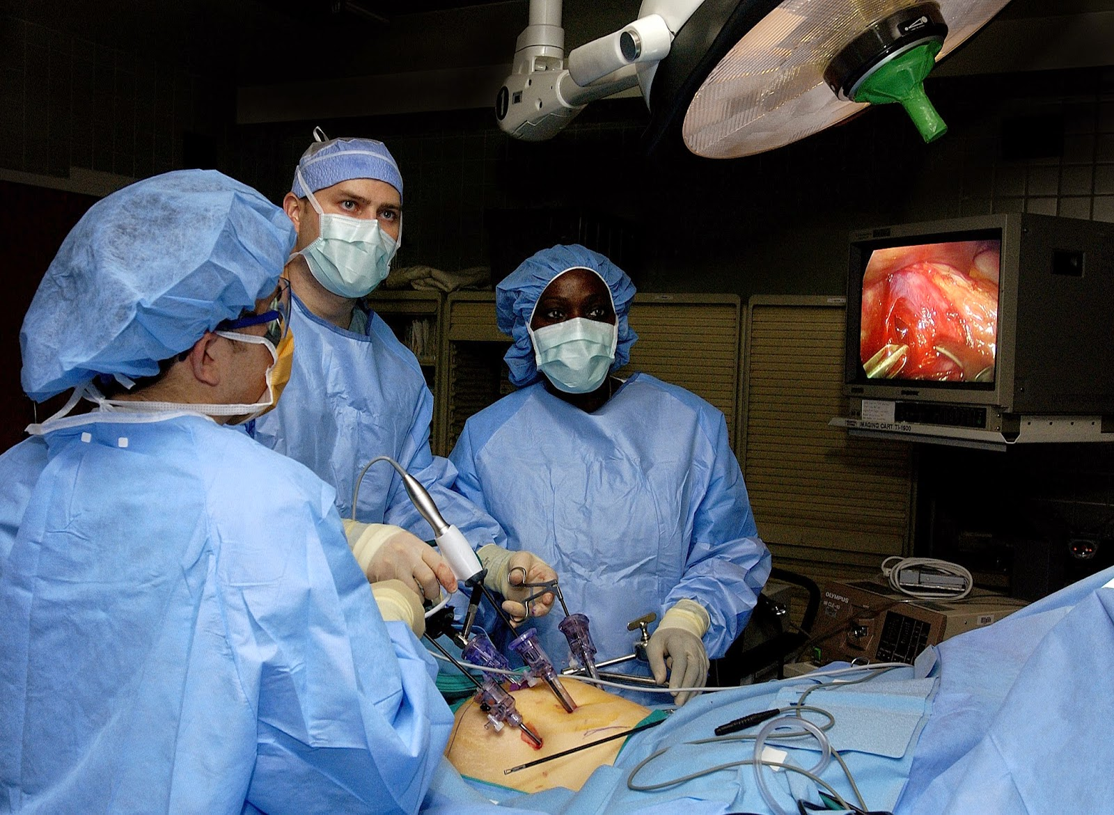 Surgeons performing bariatric surgery to a patient.