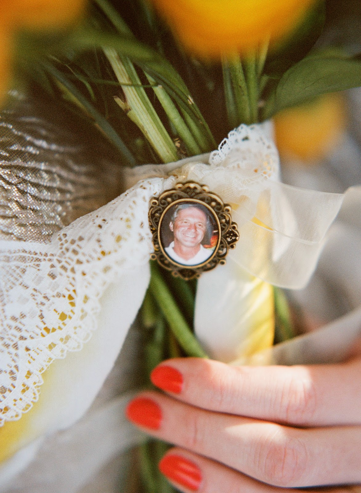 yellow and white spring bouquet tied with hand dyed silk ribbon and vintage lace with a memorial locket of the bride's father for a brooklyn, new york bride
