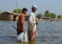 Devastating floods in Pakistan in 2010 killed hundreds of people and led to a severe outbreak of cholera. (Image Credit: Saleem Shaikh) Click to Enlarge.