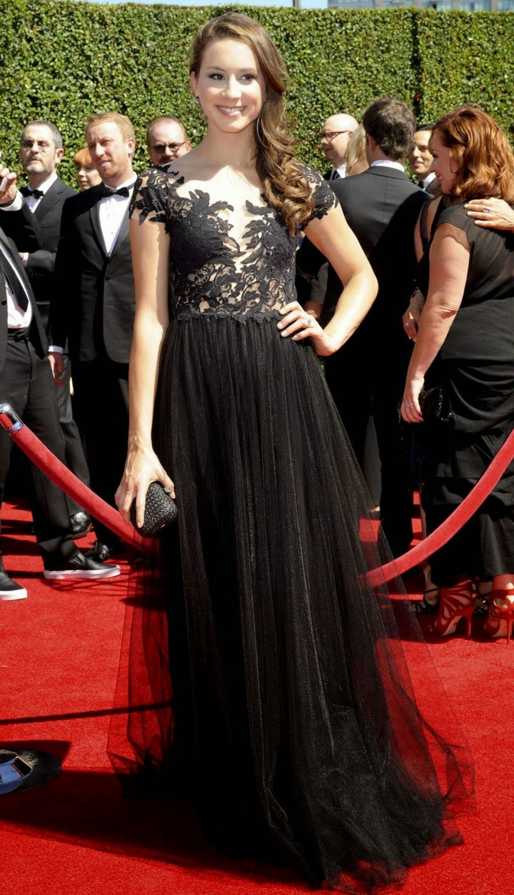 Troian Bellisario is sultry in a black lace and organza gown at the 2014 Creative Arts Emmy Awards