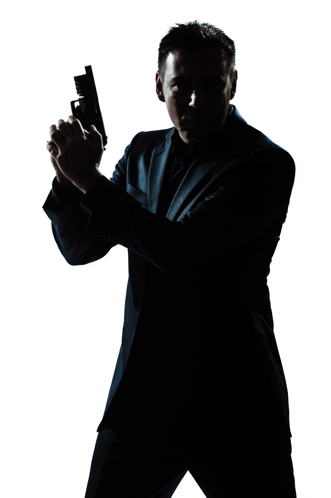 Image:  A man in a suit holds handgun.  Will A Preacher Man Rob God by collecting tithes and not taking care of the widow, the immigrant, the orphan?