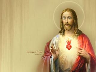 Jesus Christ sacred heart wallpaper with glow lighting around