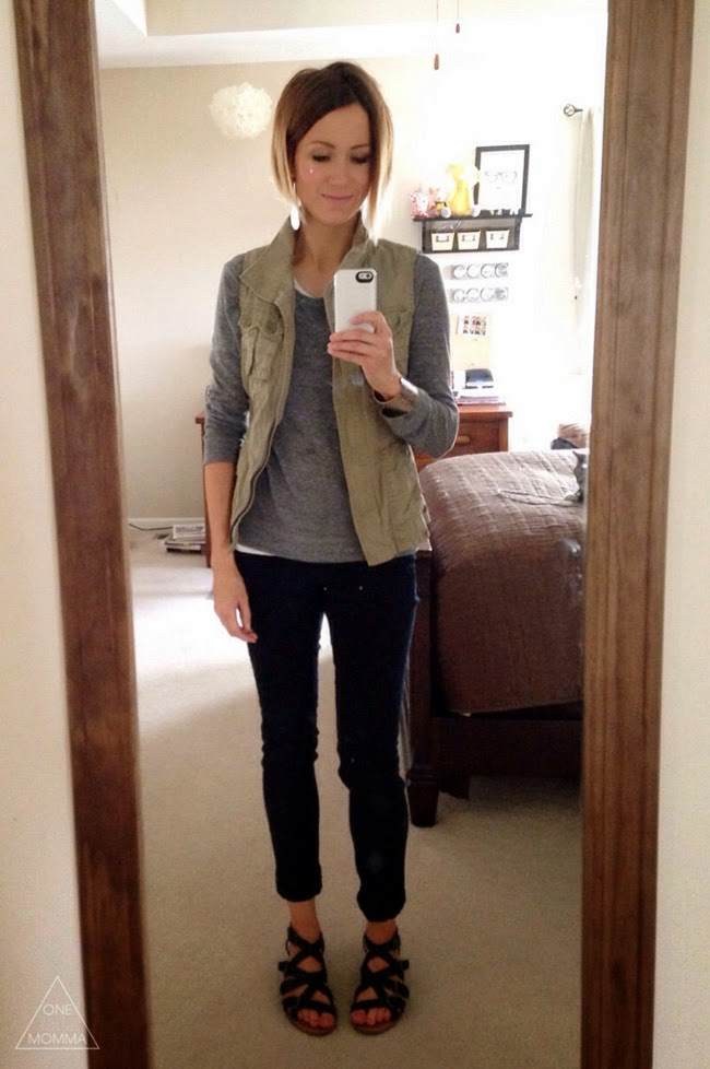 Utility vest, gray tee, black skinny jeans and strappy flat sandals