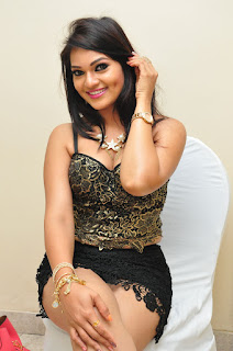 Aswini Looks Stunning in a Micro Mini Skirt and Half Deep Neck Top at Hori Hori Audio Release