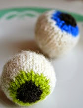 http://www.ravelry.com/patterns/library/gruesome-knitted-eyeballs