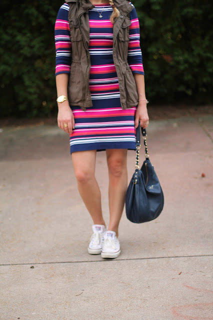 Pink and blue striped dress with utility vest, Converse, and navy Kate Spade bag