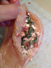 Image shows pocket in chicken breast, filled with spinach mixture.