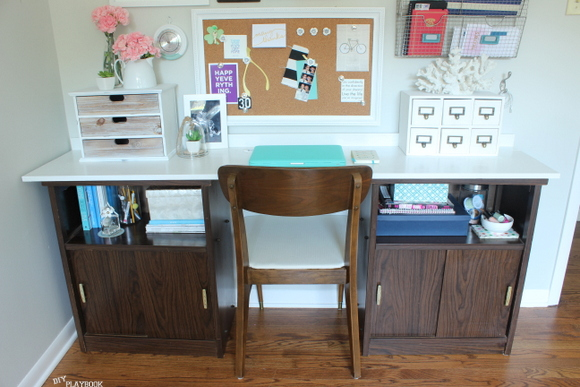 The Goodwill cabinets are unrecognizable in the office desk and gallery wall reveal!