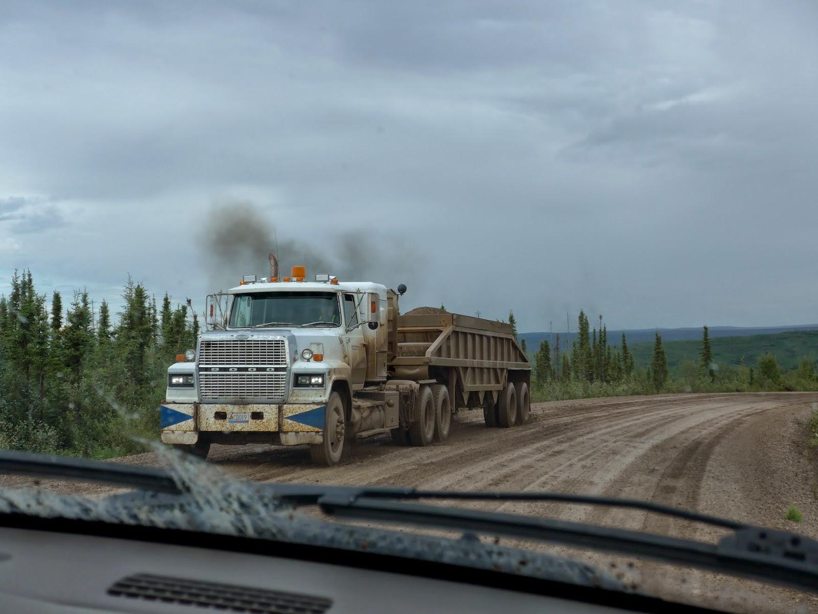 Semi truck hauling gravel.