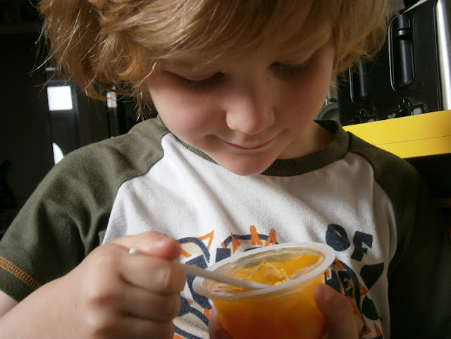 boy eating fruit in jelly
