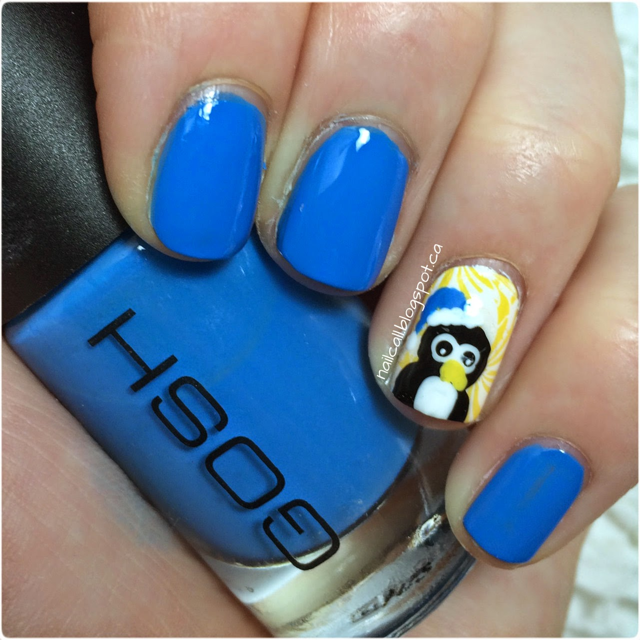 Blue nail polish with penguin accent nail