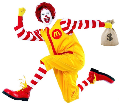 Ronald McDonald running with a bag o' money