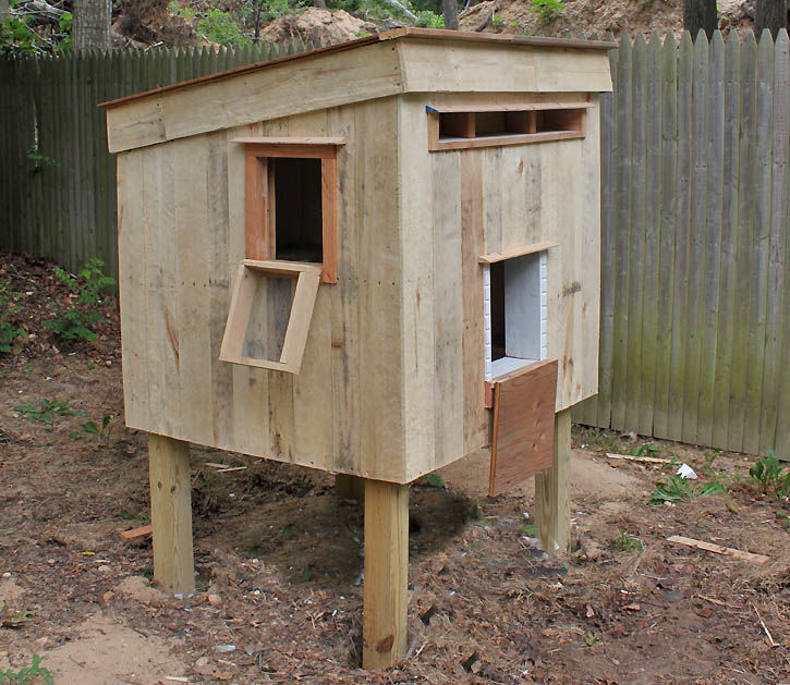 Chicken coop from recycled pallets gina michele for How to build a chicken coop from wooden pallets