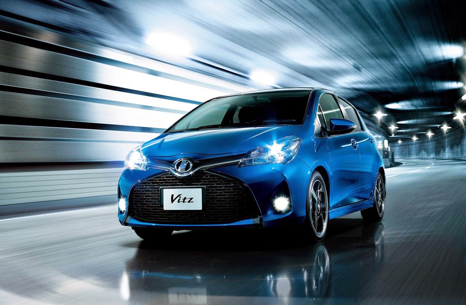 Blue Toyota Vitz driving