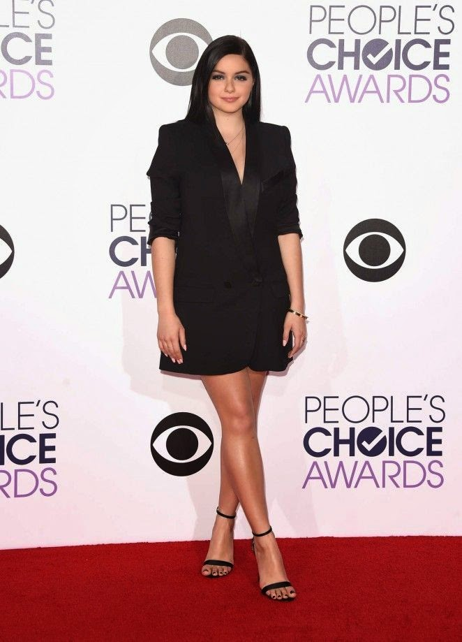 The 16-year-old looked fresh in a dark cutaway dress as she walked by herself to the red carpet event at Los Angeles, CA, USA on Wednesday night, January 7, 2015.