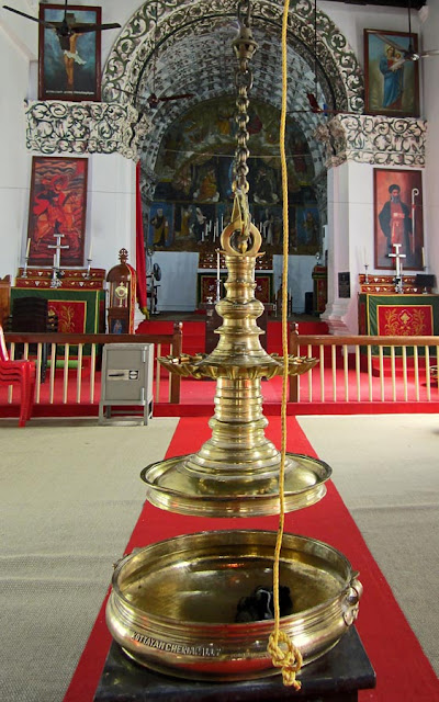 brass lamps at ancient Kerala church