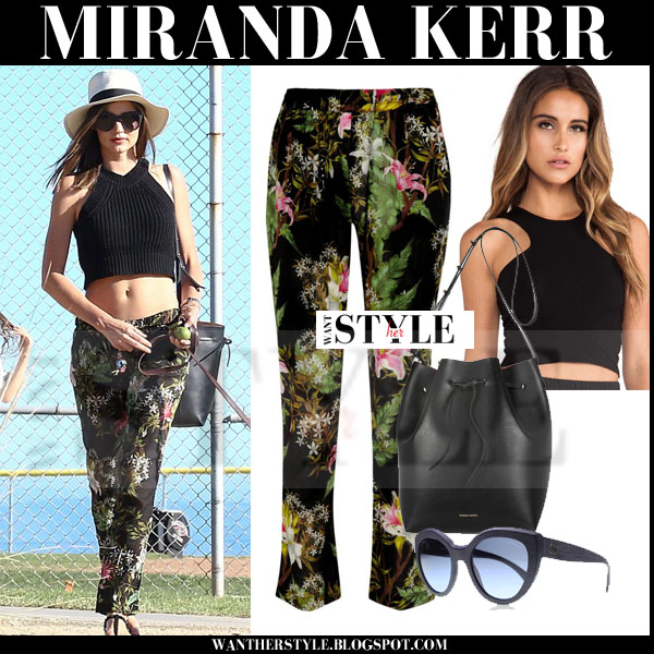 Miranda Kerr in black donna mizani crop top and floral print isabel marant wilford pants streetstyle models off duty