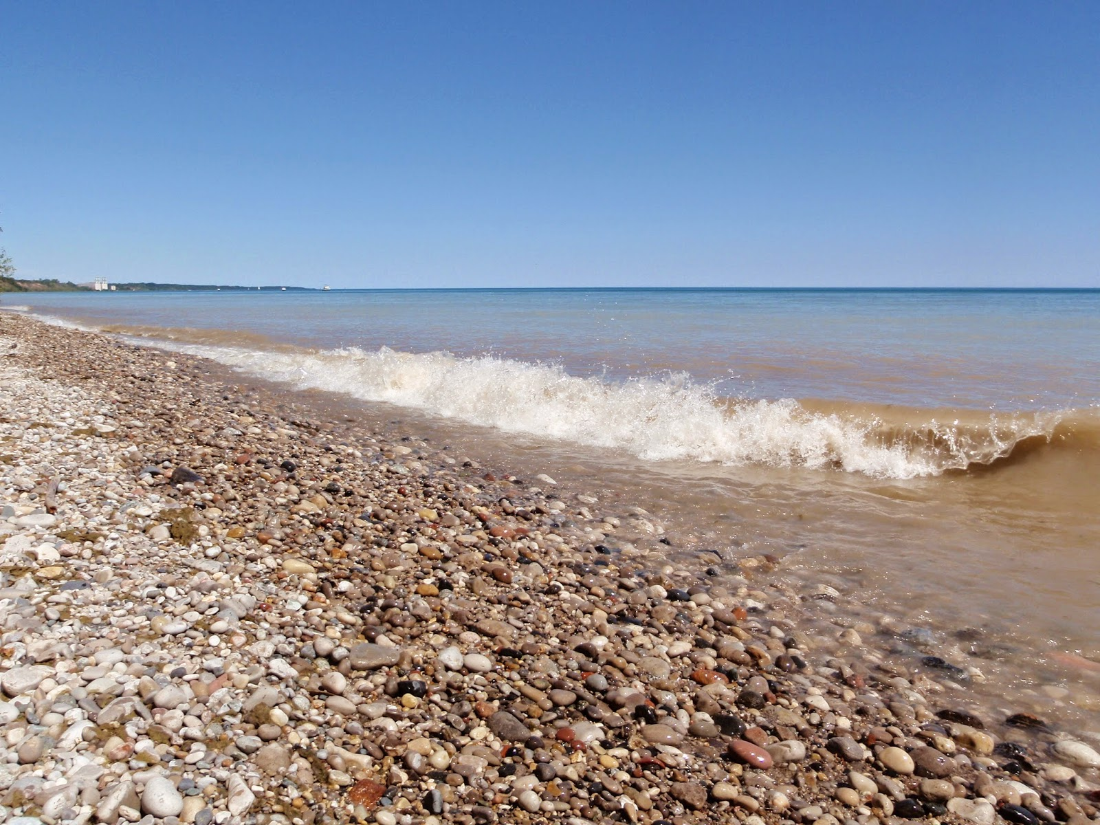 Waves crashing along the Lake Michigan shoreline at Lion's Den Gorge Nature Preserve