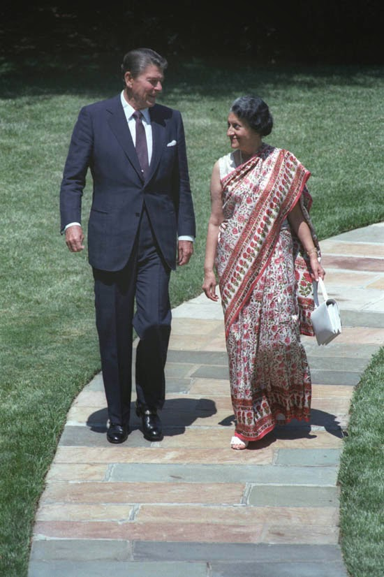 US President Ronald Reagan walking with Indian Prime Minister Indira Gandhi outside the Oval Office, White House - Washington DC July 1982