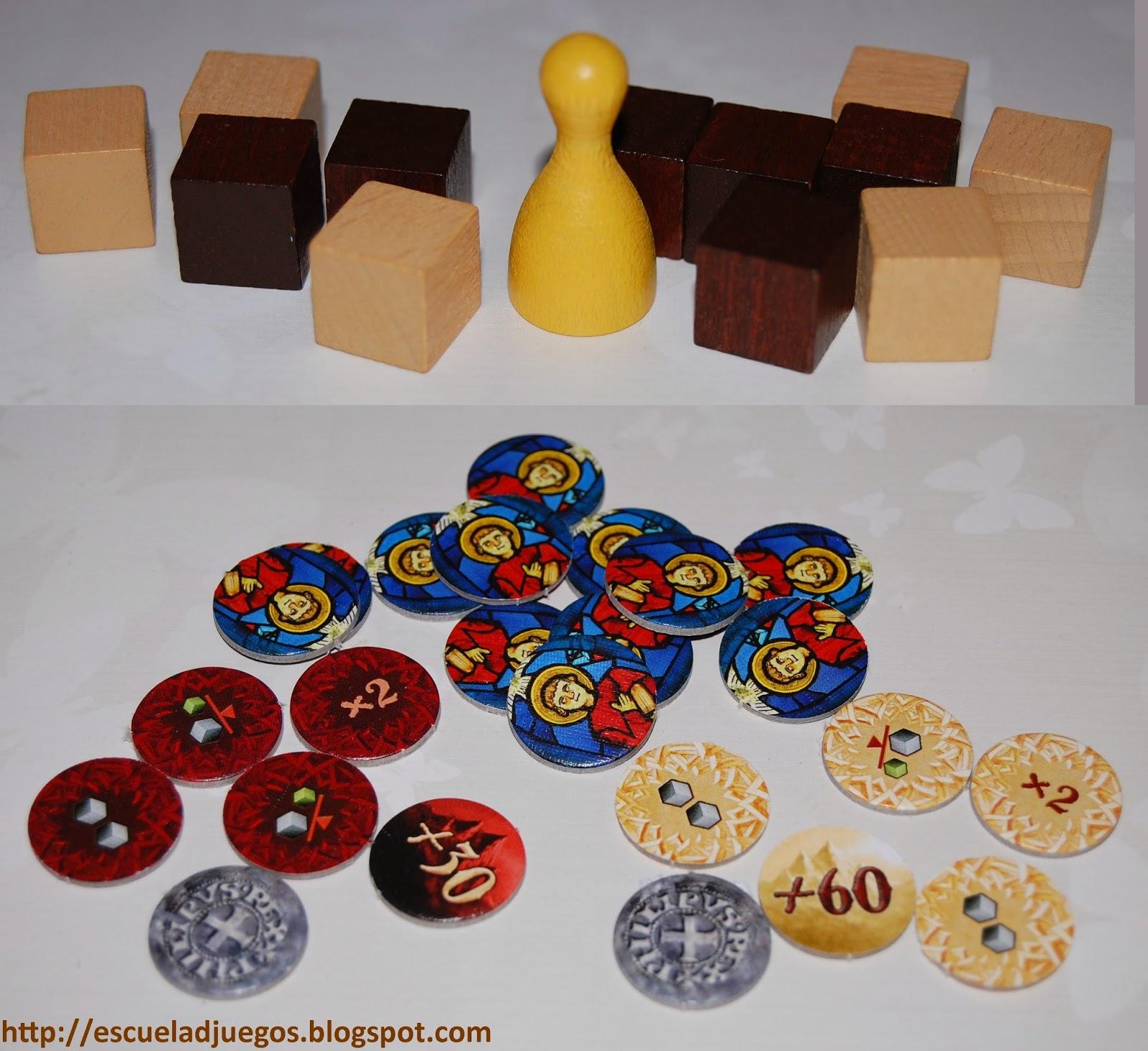 Cubos (trabajadores) y peón del rey, y diversos marcadores del juego
