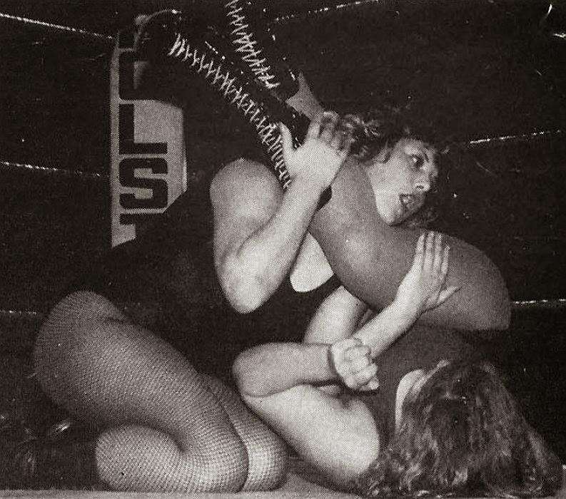 Lena Blair on the recieving end of Busty Keegan's headscissors.