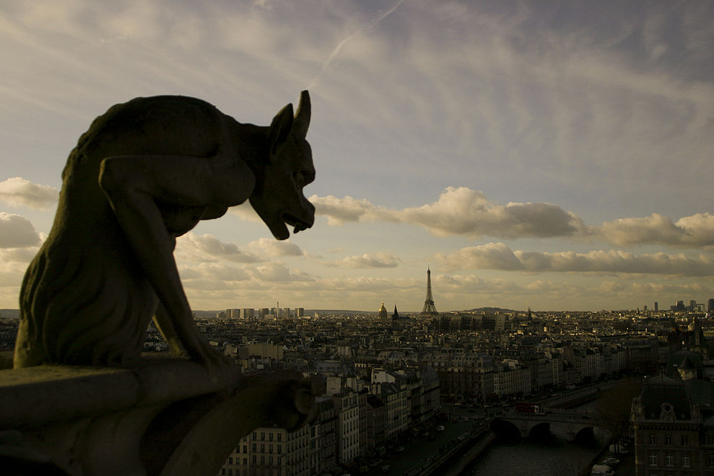 A grotesque statue overlooking the Paris skyline