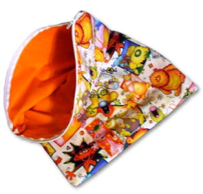 a cloth diaper wet bag with storybook illustrations on it