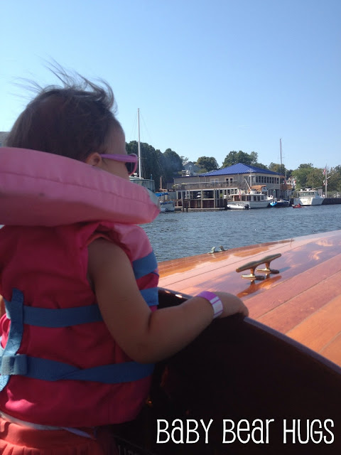 Baby riding on a boat