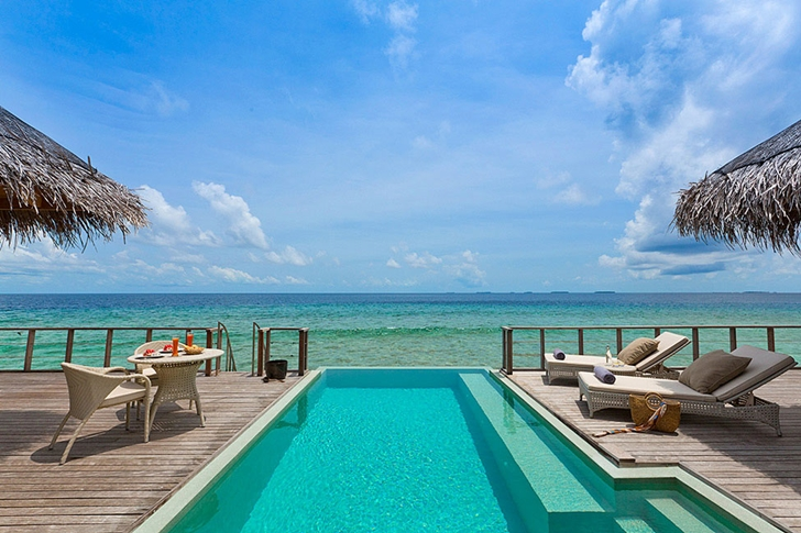Wooden deck with swimming pool in Luxury Dusit Thani Resort in Maldives