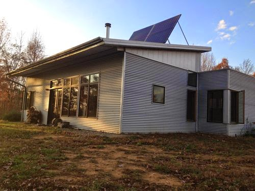 Lazy passive solar prefab house as fall sets in deepens for Passive solar prefab homes