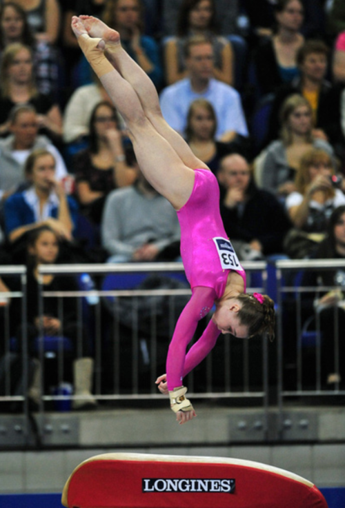 Female gymnasts with large muscular calves - set 1 -