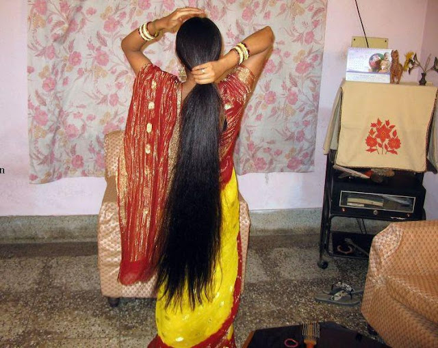 Tamil girl ties her loose open long hair with hairband to make ponytail