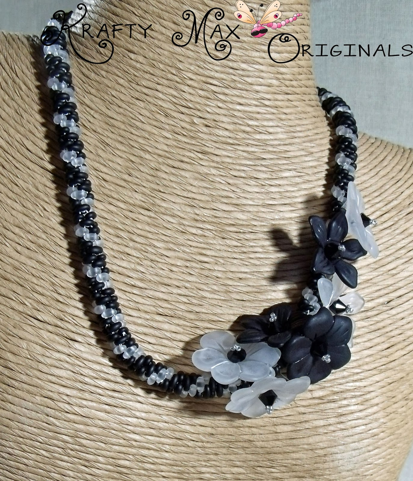 http://www.lajuliet.com/index.php/2013-01-04-15-21-51/ad/beadwork,46/exclusive-black-and-white-flowery-grace-beadwoven-necklace-a-krafty-max-original-design,346
