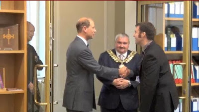 The Earl of Wessex being greeted by Paul Stebbing at the door to the Archives watched by the Mayor