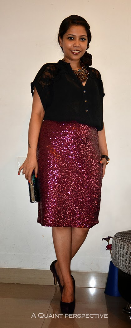 A shimmering sequined clutch in jewel tones