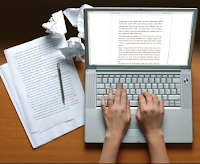 writing on paper and laptop