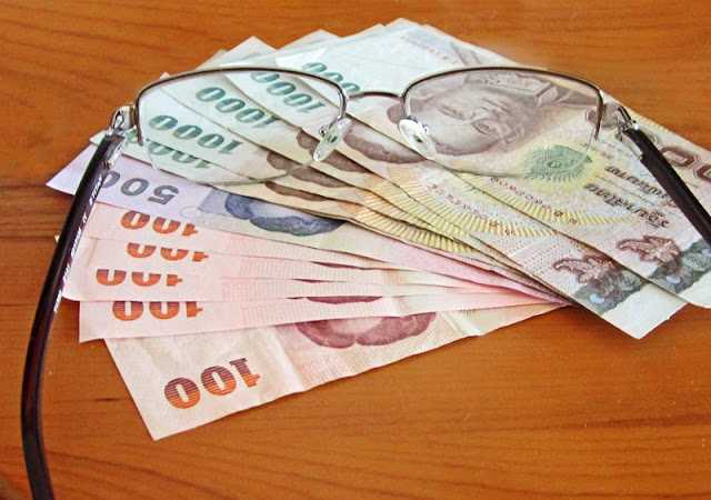 Baht notes and spectacles