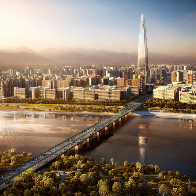 Photo of Lotte World Tower at sunset as seen from the air behind the river