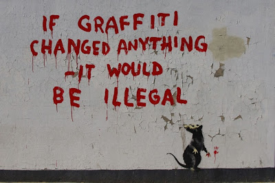 graffiti on wall, if graffiti changed anything it would be illegal